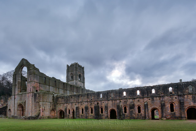 Main building of the Cistercian Fountains Abbey on an overcast day