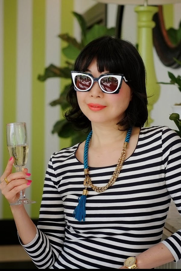 Vivalaviv's Vivienne Shui wears the 50's style FENDI sunglasses from the SS 2015 range.