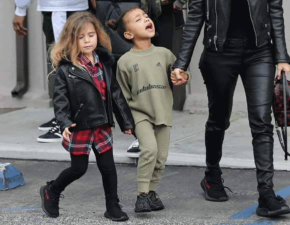 kanye wests kids model his new childrens clothesand