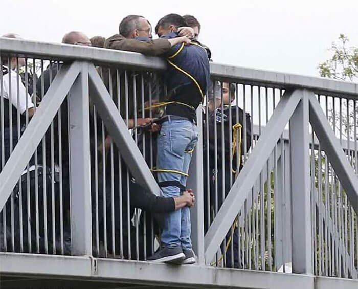 30 Heartwarming Photos That Restored Our Faith In Humanity - People Holding Onto Man Trying To Commit Suicide