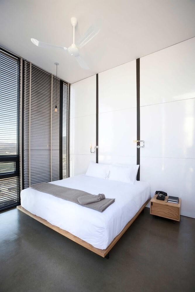05-Minimalist-Bedroom-Gracia-Studio-Cabin-Architecture-set-on-a-Hill-www-designstack-co