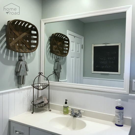 Framed mirror in the bathroom