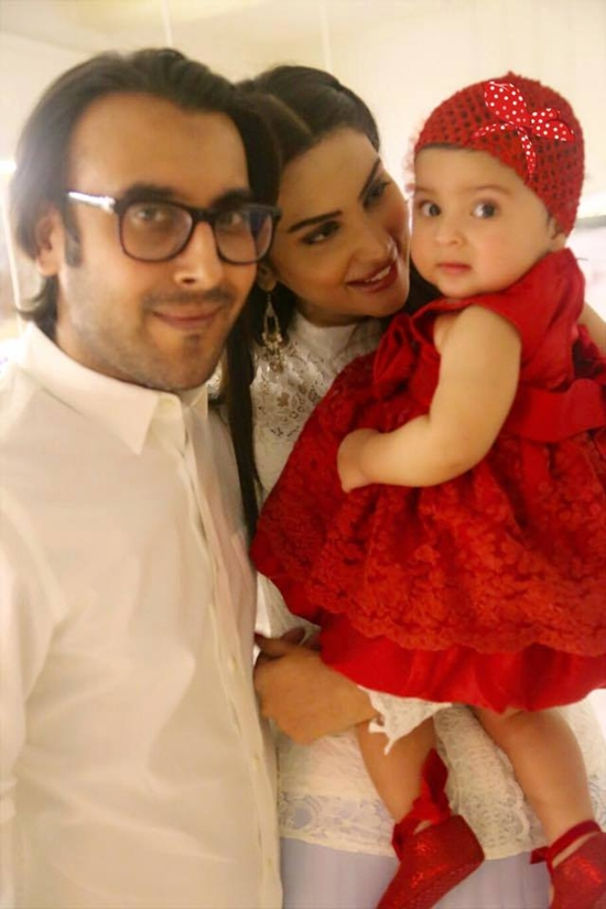 Fiza Ali with her husband and daughter