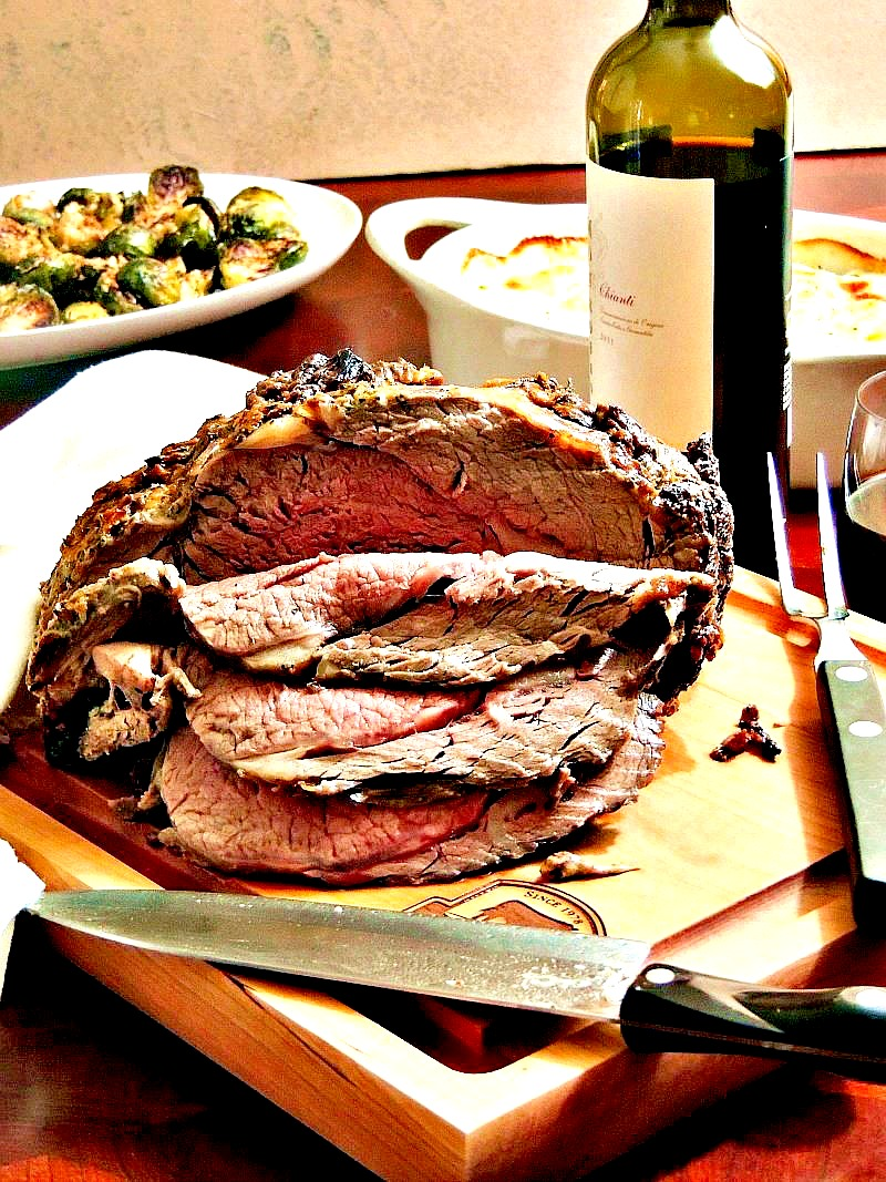 THE BEST BONELESS RIB ROAST WITH ROASTED GARLIC AND HERBS - Impress your family and friends with this amazing rib roast as the center of your holiday meal! From www.bobbiskozykitchen.com #beef #roast #roastperfect #bestangusbeef