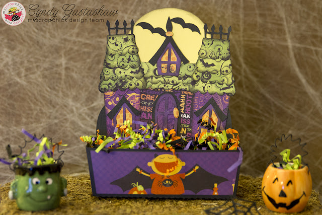 Candy dish with haunted house pictured on it