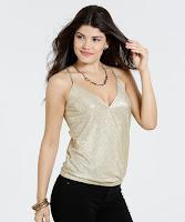 Blusa feminina metalizada confeccionada em tecido poliéster com aplicação foil