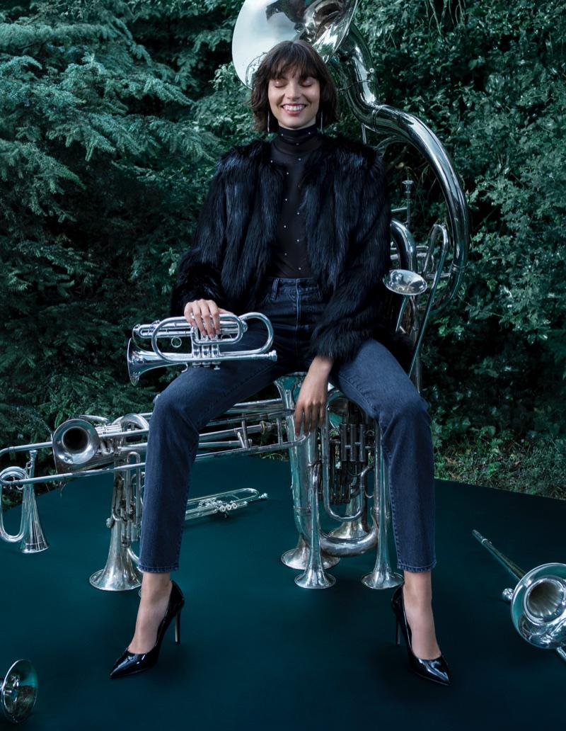 Charlee Fraser wears H&M Faux Fur Jacket, Mesh Turtleneck Top, Vintage High Cropped Jeans and Pumps