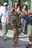Priyanka Chopra looks super cute in happy mood wearing a short flower print dress in Hollywood 014.jpg