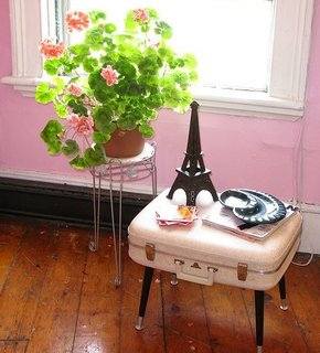 This vintage suitcase coffee table is adorable with an Eiffel Tower statue for any girls room.