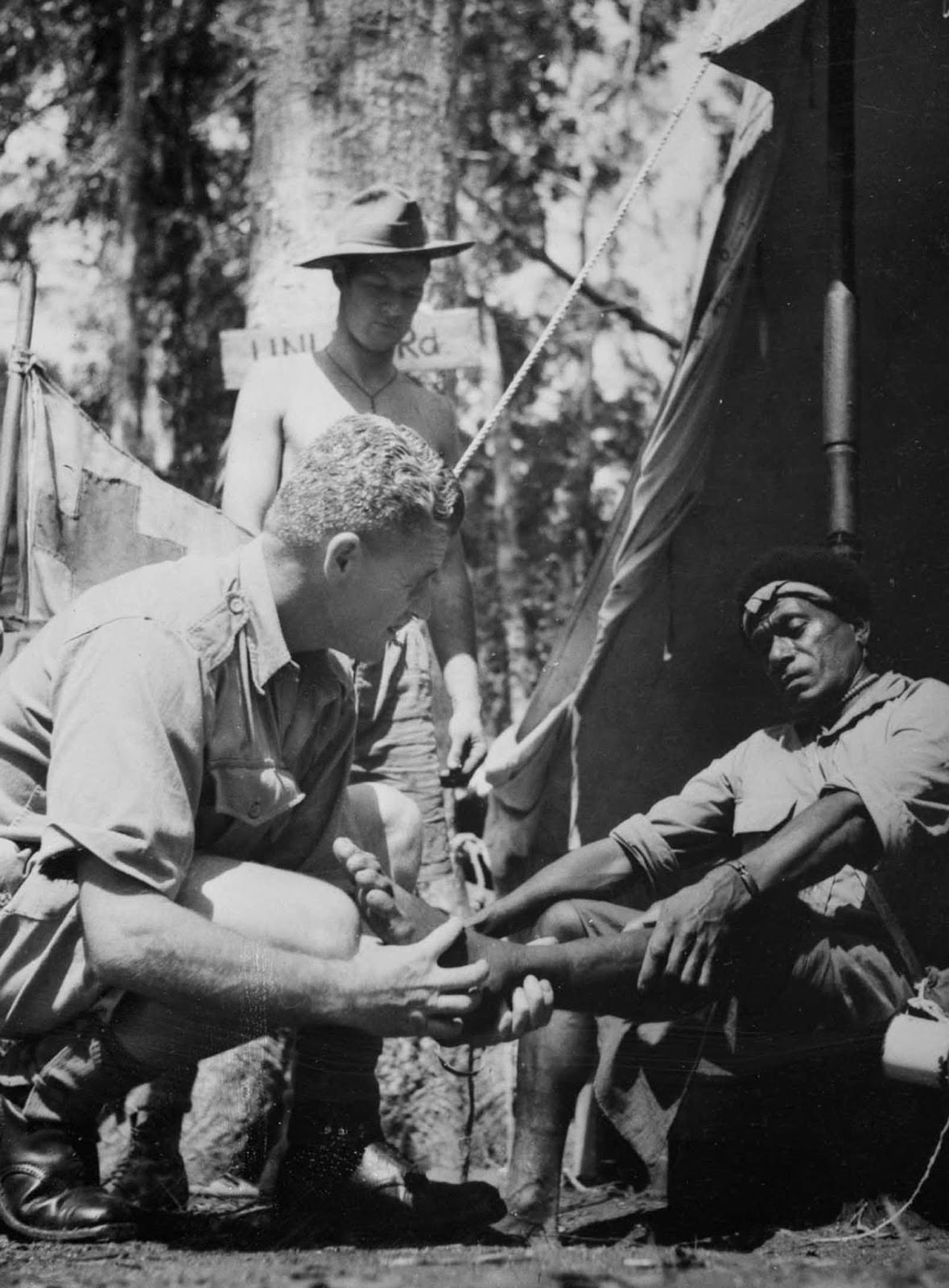 A carrier receives medical attention at an Allied forward outpost.