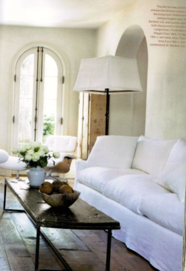 Pamela Pierce designed living room in her own European country home filled with antiques and white. #frenchcountry #livingroom #pamelapierce #interiordesign