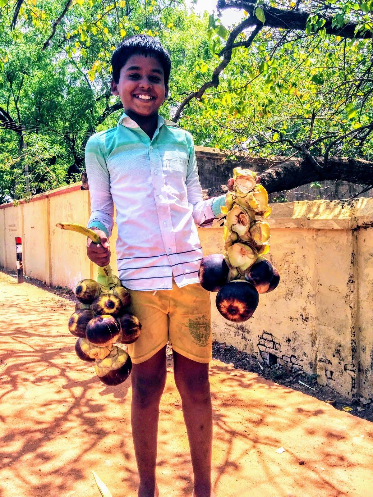 Kid all smiles with his Palm fruit at Kallidaikurichi