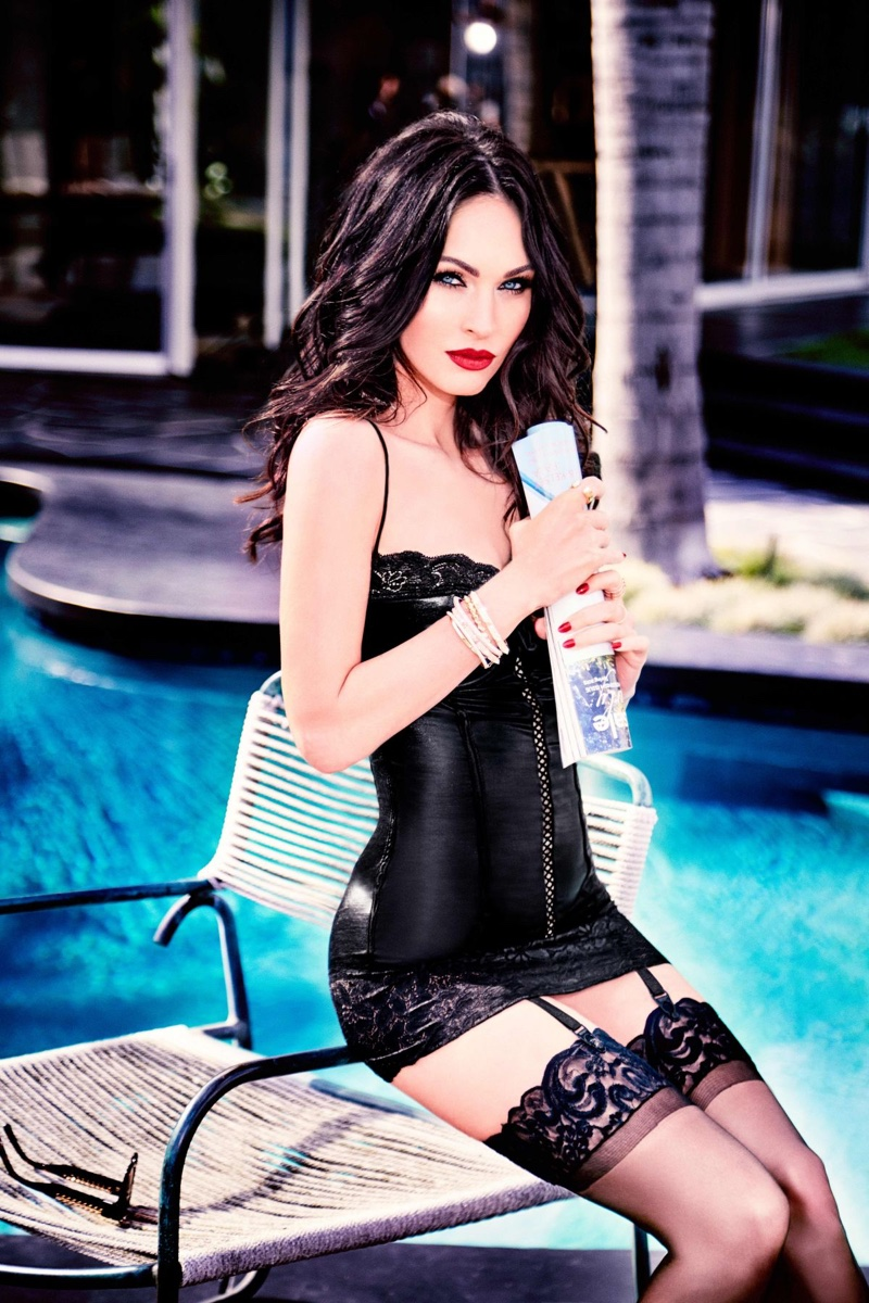 Megan Fox poses in black corset and hosiery from Frederick's of Hollywood