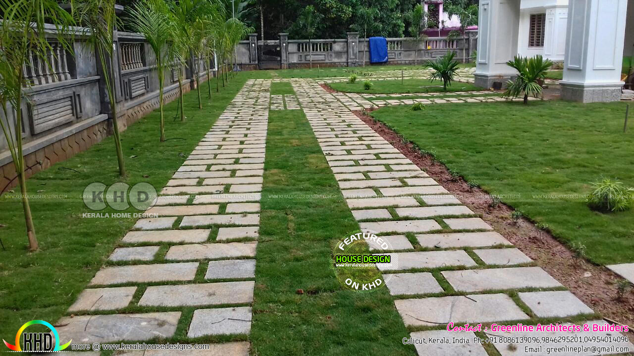 Finished colonial house in kerala kerala home design and for Kerala style garden designs