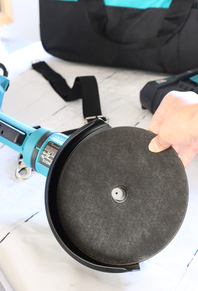 Makita angle grinder with speed change technology to adjust speed and torque during operation.