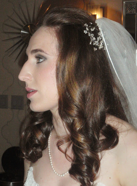 bride with smoky eyes and pink lips