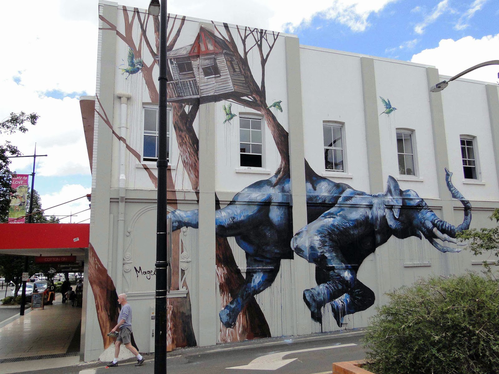 Fintan Magee spent the last few days in Toowoomba, a city in South-East Queensland, Australia, where he worked his way through this massive street art piece.