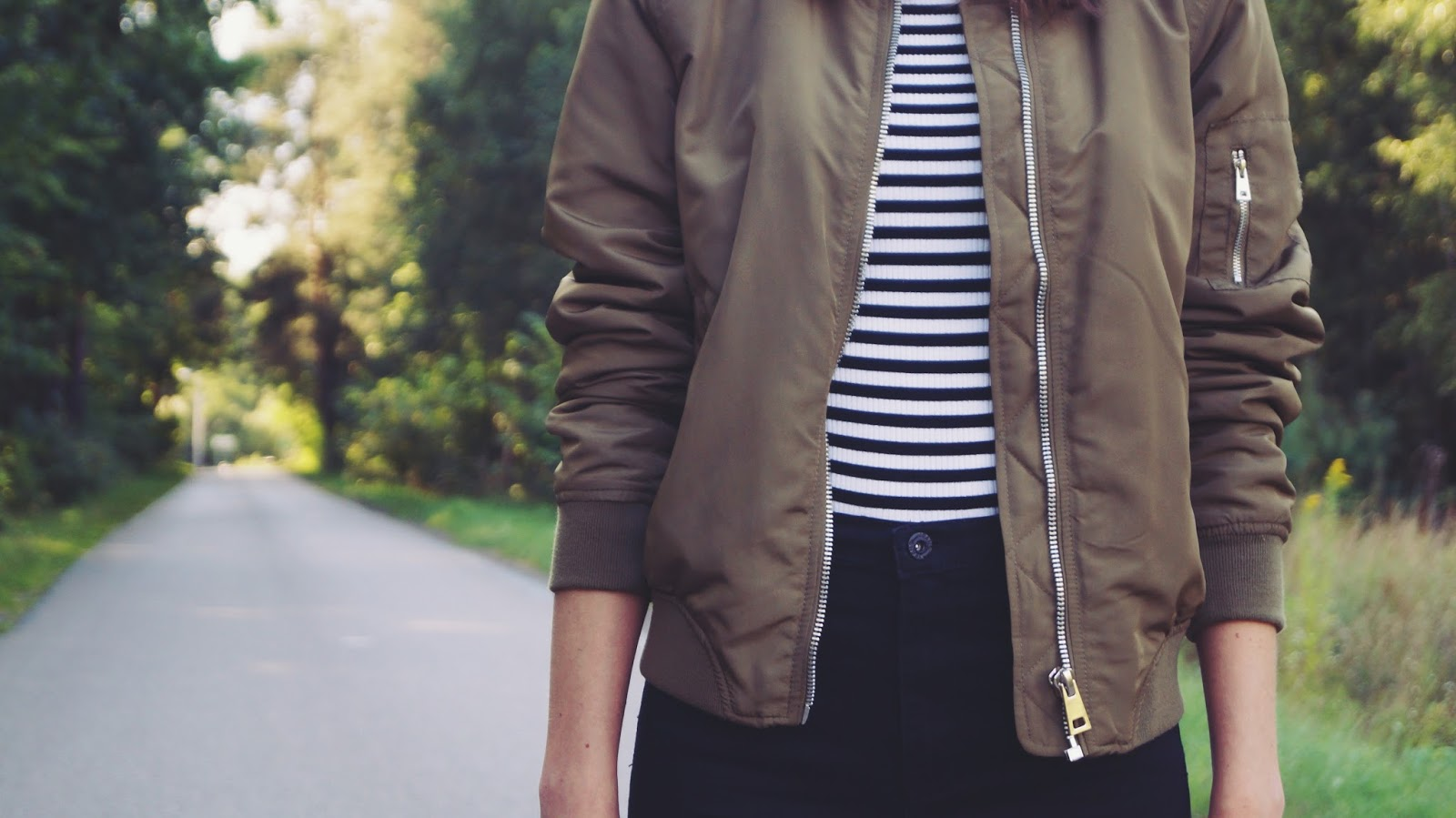 Khaki bomber, stripes and black jeans