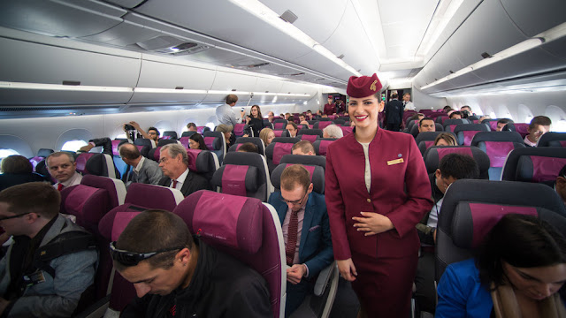 Flight attendant inside of plane