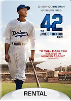42 cover showing actor playing Jackie Robinson standing on baseball field