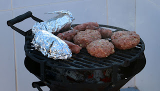 Home made burgers, sausages and sweetcorn
