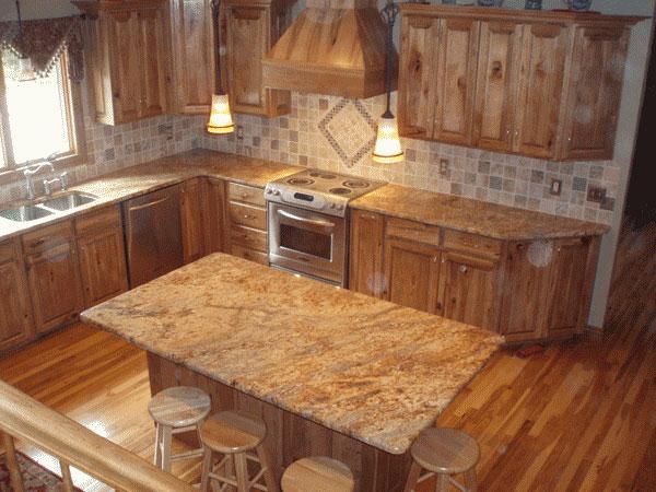 Encimeras de granito y muebles de madera para la for Piedra granito para cocina precios