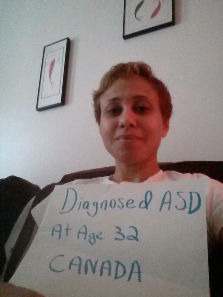 one quarter mama smiling and holding a paper that says diagnosed ASD at age 32.