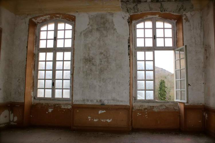 Tall French windows stripped wallpaper decay Chateau de Gudanes