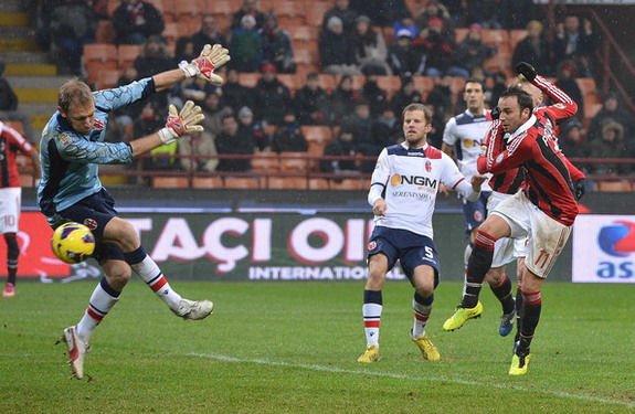 AC Milan striker Giampaolo Pazzini scores his team's second goal against Bologna
