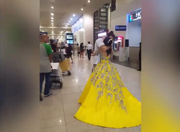 Heartwarming dance at the airport by OFW dad and his debutante daughter