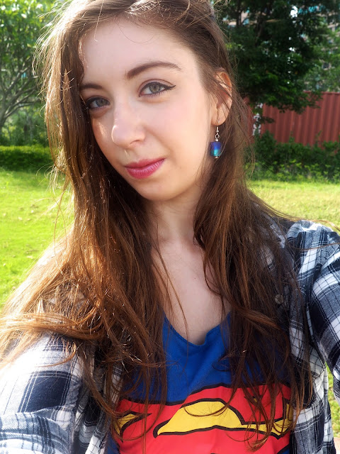 Girl of Steel | outfit details of blue stone dangly earrings with Supergirl top & checked shirt