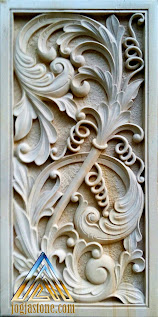 Ukiran untuk tempelan dinding dibuat dari batu alam paras jogja/Batu putih