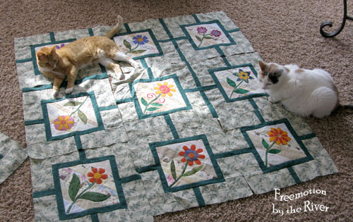 Flower Maze quilt pieces and cats at Freemotion by the River
