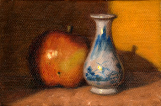 Oil painting of a red Fuji apple beside a small white porcelain vase with blue pattern.