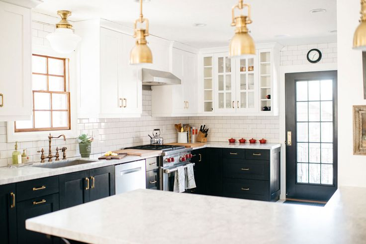 Brass Kitchen Lights: Brass fixtures, lights, and hardware look classic in this black and white  kitchen.,Lighting