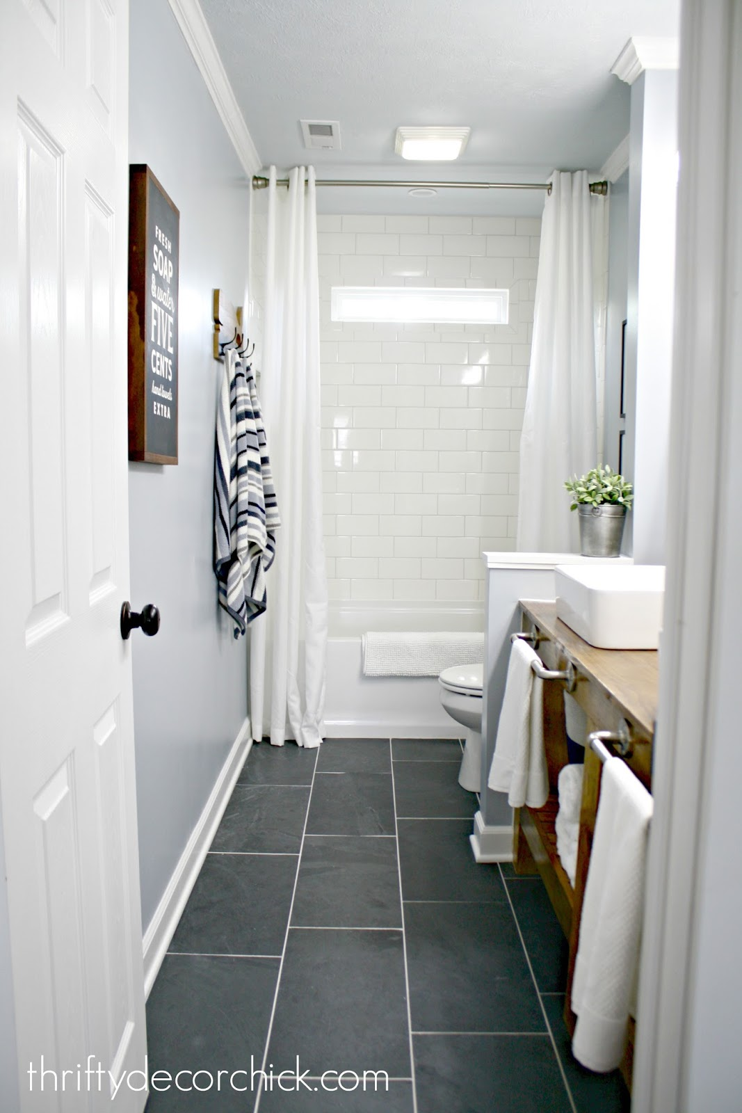 Bathroom reveal after knocking out a wall