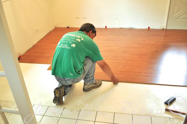 Putting down laminate flooring over tile