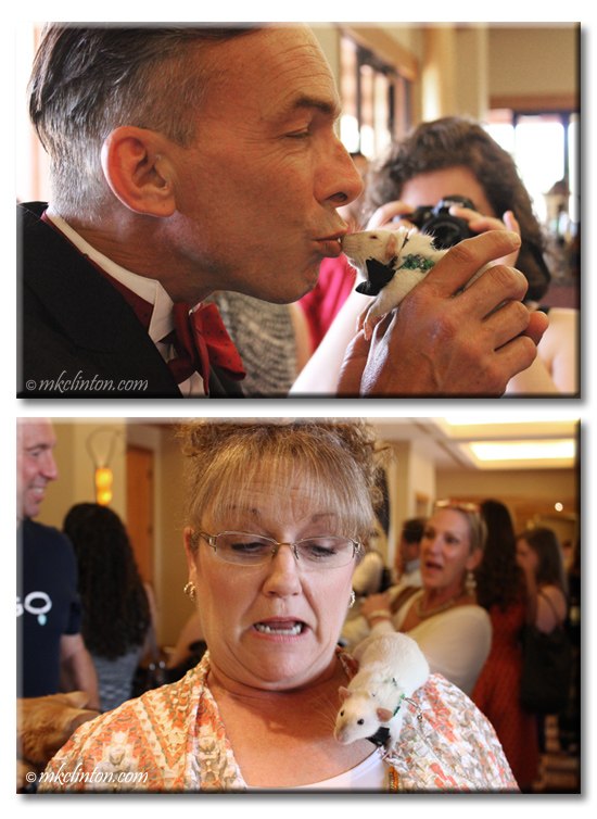 Man in tux kissing rat, woman shocked over rat on her shoulder