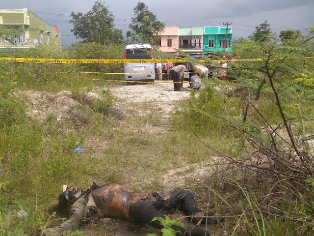 Penemuan mayat di lahan kosong.
