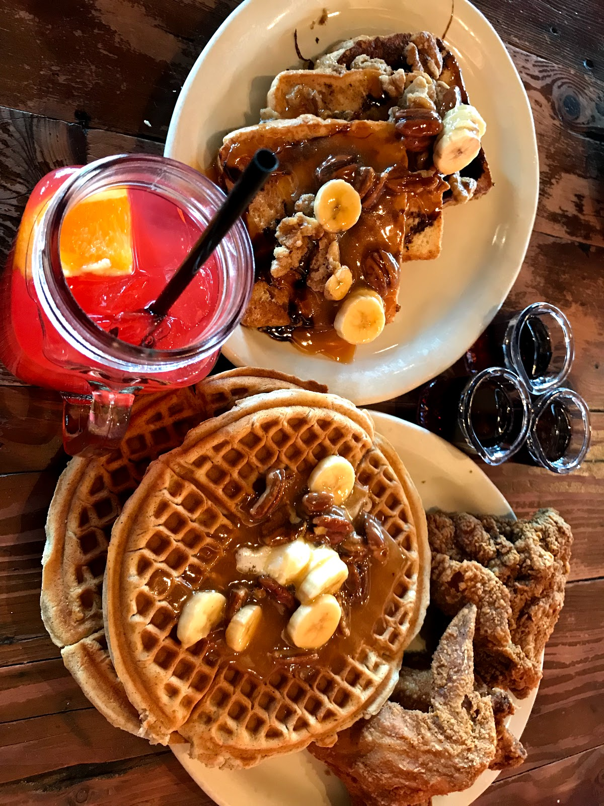Image: Waffles, Eggs , bacon, and drinks on table at LoLo's Chicken and Waffles. A review on Bits and Babbles