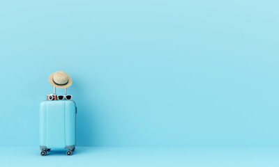Blue suitcase on blue background for overcome travel fears concept