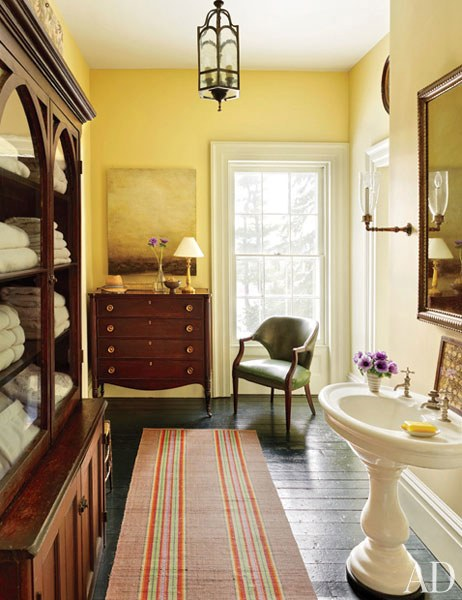 Antiques in a master bath content in a cottage for Architectural digest bathrooms 2016