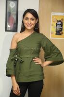 Pragya Jaiswal in a single Sleeves Off Shoulder Green Top Black Leggings promoting JJN Movie at Radio City 10.08.2017 085.JPG
