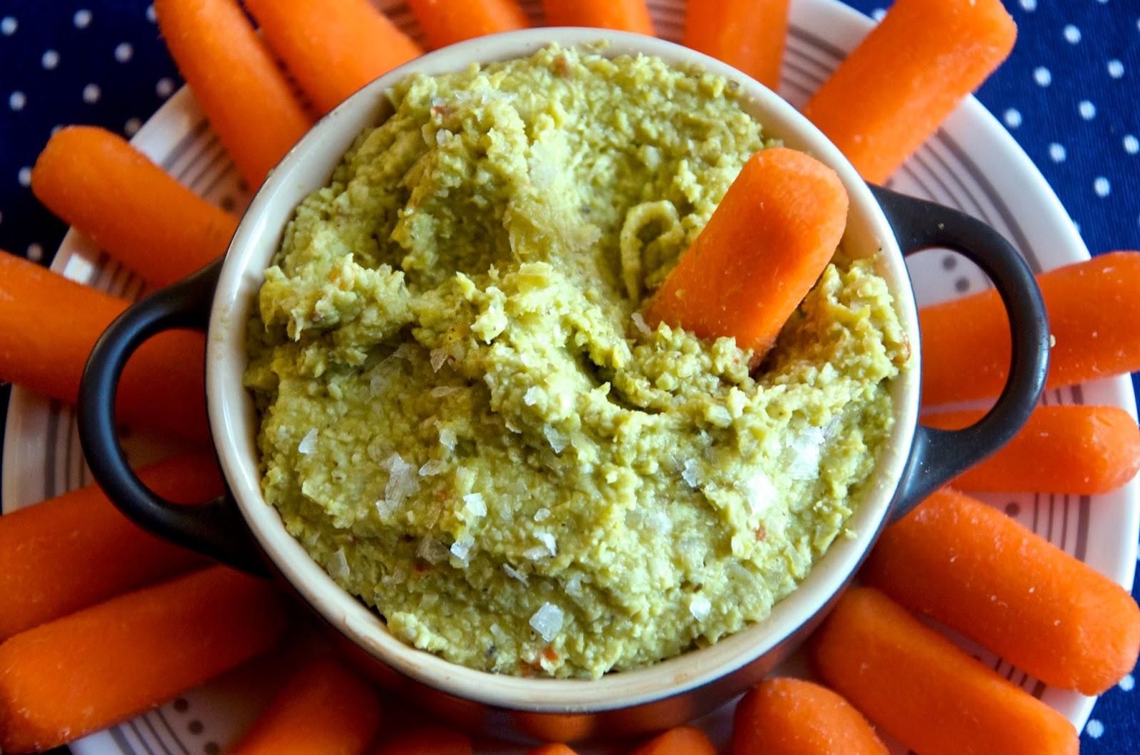 Carrot dipped in edamame pea dip