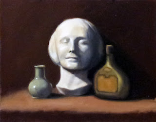 Oil painting of a small vase, a plaster cast of a young woman's face and a liqueur bottle.