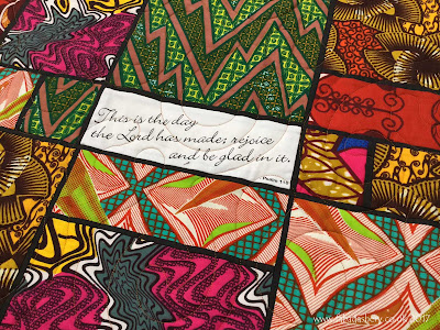 African quilt incorporating bible scriptures