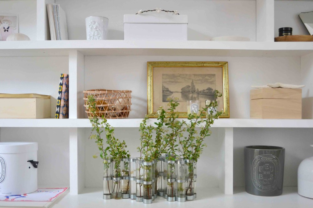 Modern farmhouse living room with white builtin shelves with objects and books in 1650 Marais Paris home of Lucille Gauthier-Braud. #shelves #builtins #livingroomdecor