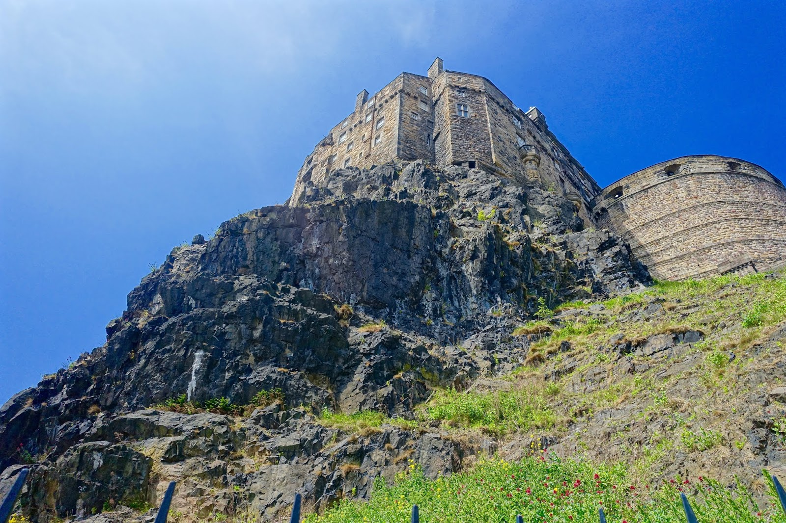 edinburgh castle in the sushine with blue sky backdrop