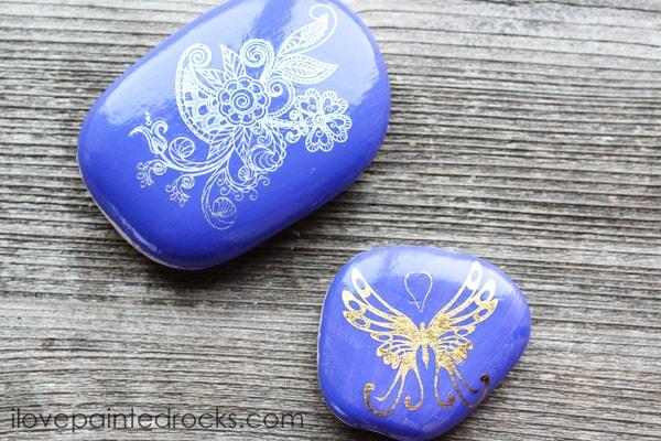 rocks painted with metallic temporary tattoos