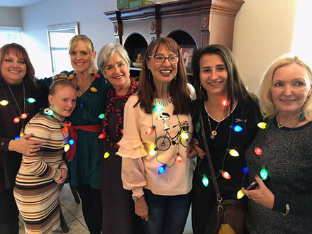 Resident Astronomer Peggy and family ladies with electric Christmas necklaces (Source: Palmia Observatory)
